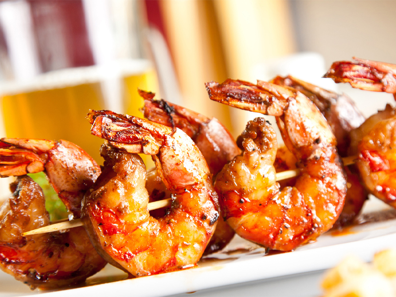 Buffalo flavored shrimp on skewers
