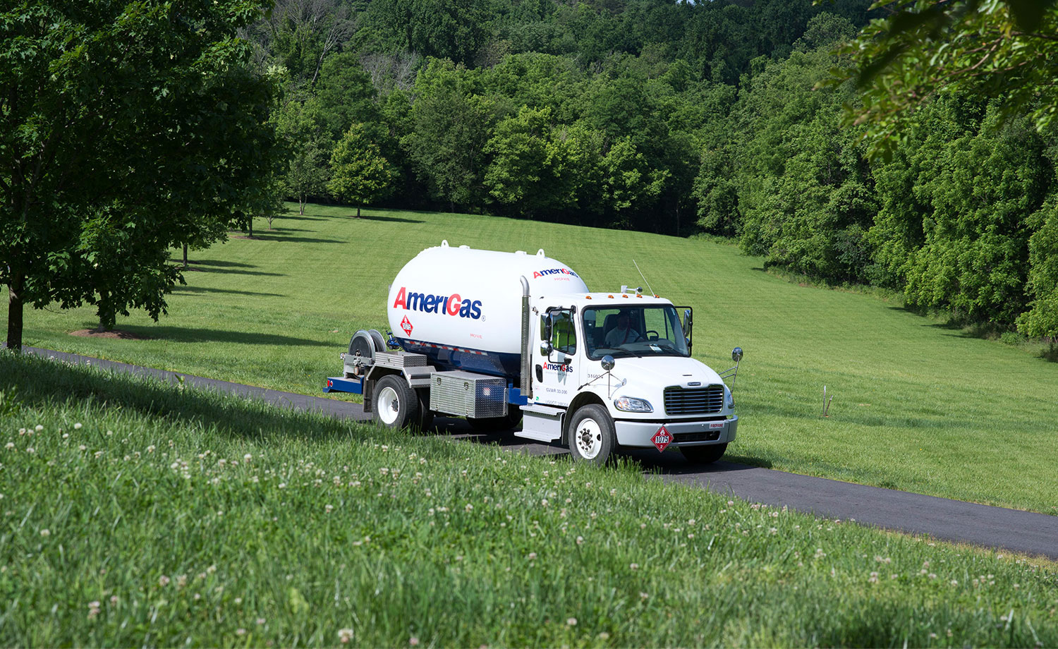 AmeriGas tanker truck on a lush rural road.