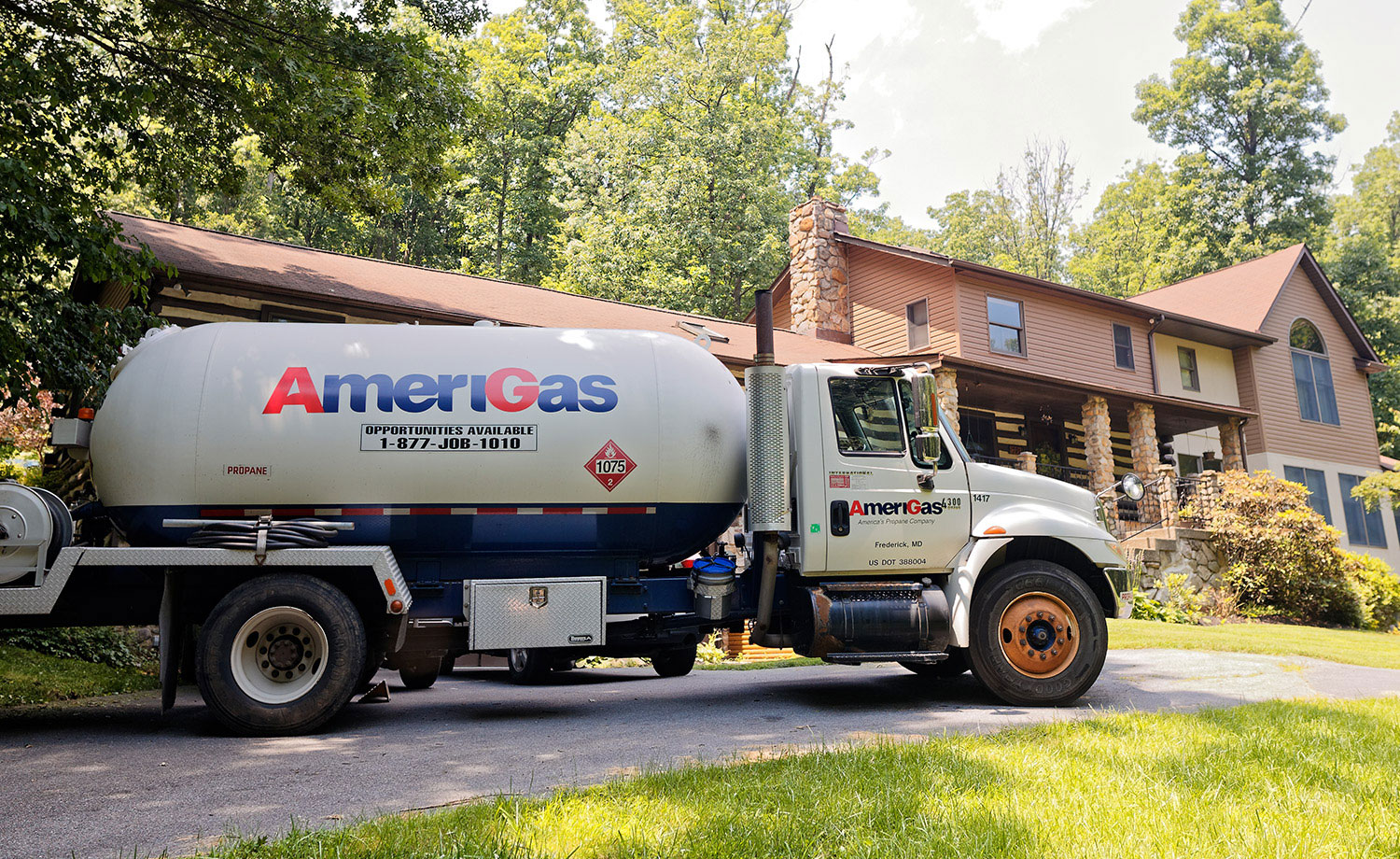 AmeriGas Tanker truck in front of a house.