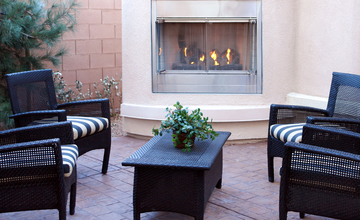 Outdoor seating area with fireplace.