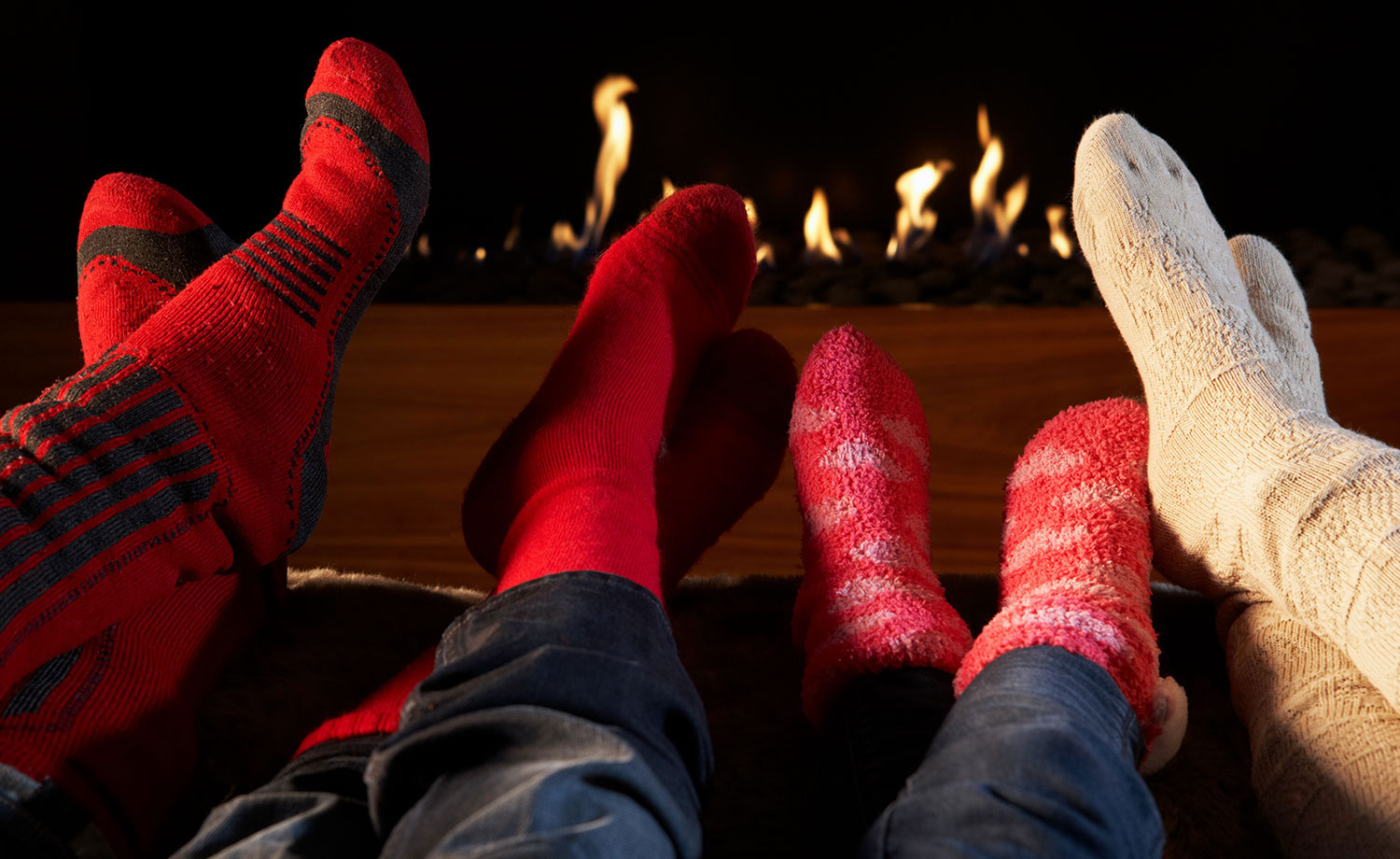 Feet in front of fireplace.