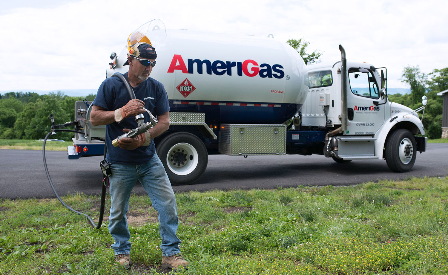 Man carrying propane line.