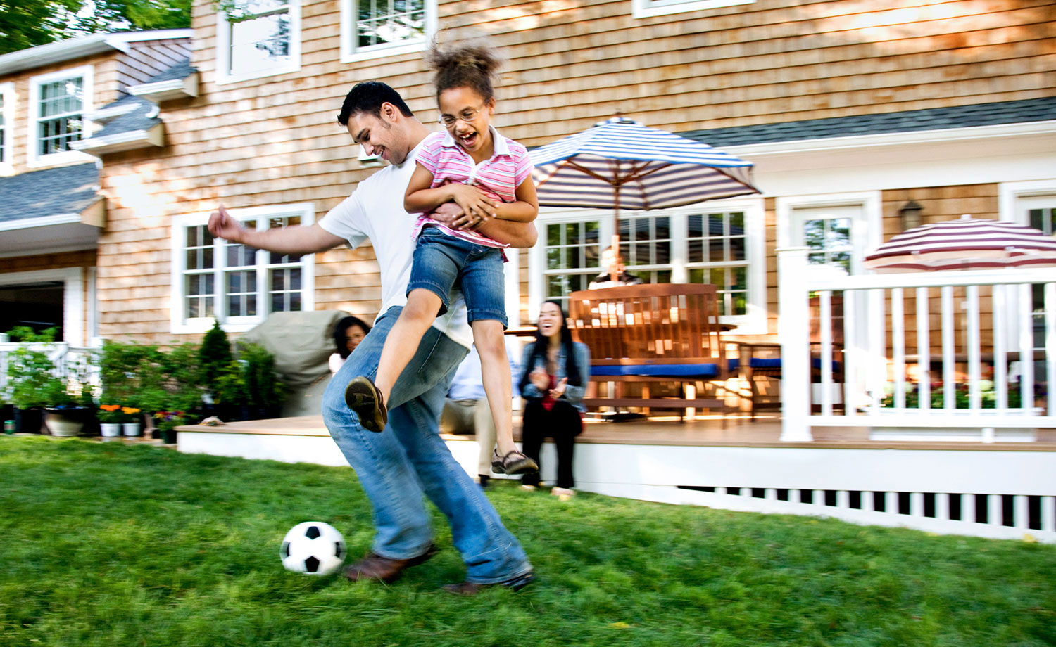 Family playing soccer.