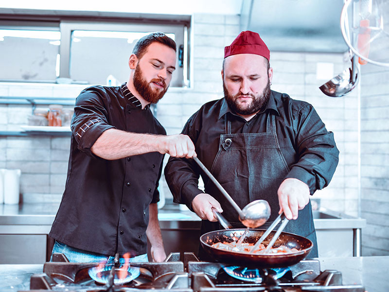Two chefs cooking.
