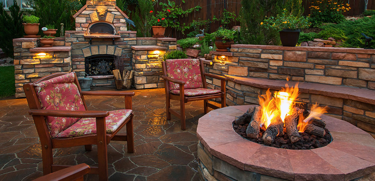 Stone patio with firepit.