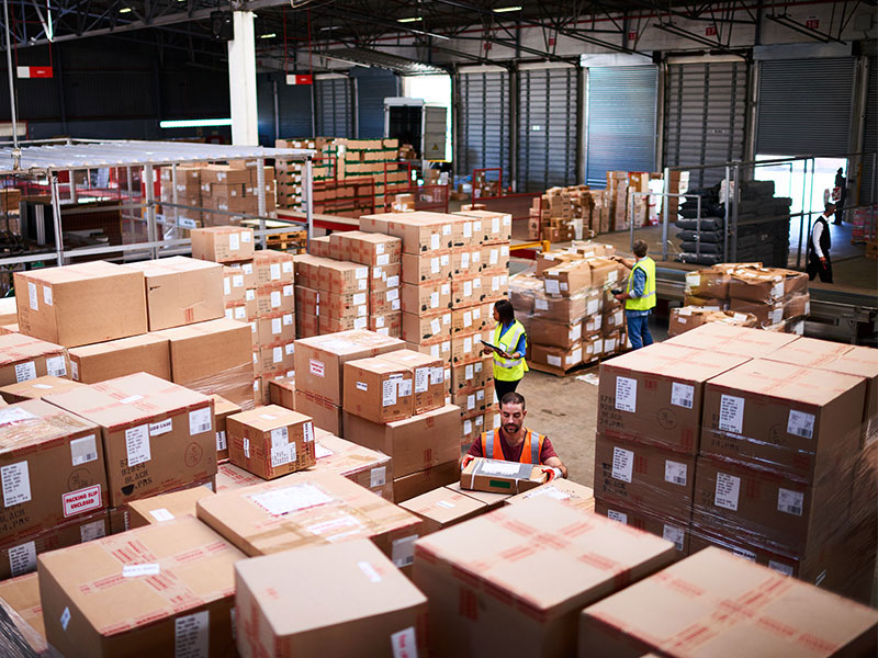 Warehouse with workers and boxes