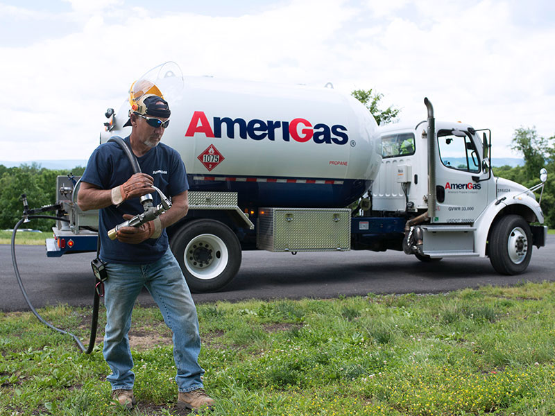 AmeriGas Truck with worker holding propane hose
